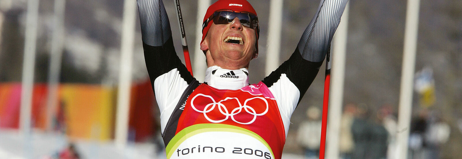 Dr. Georg Hettich: Olympia-Sieg 2006 in Turin in der Nordischen Kombination. Foto: Sammy Minkoff.