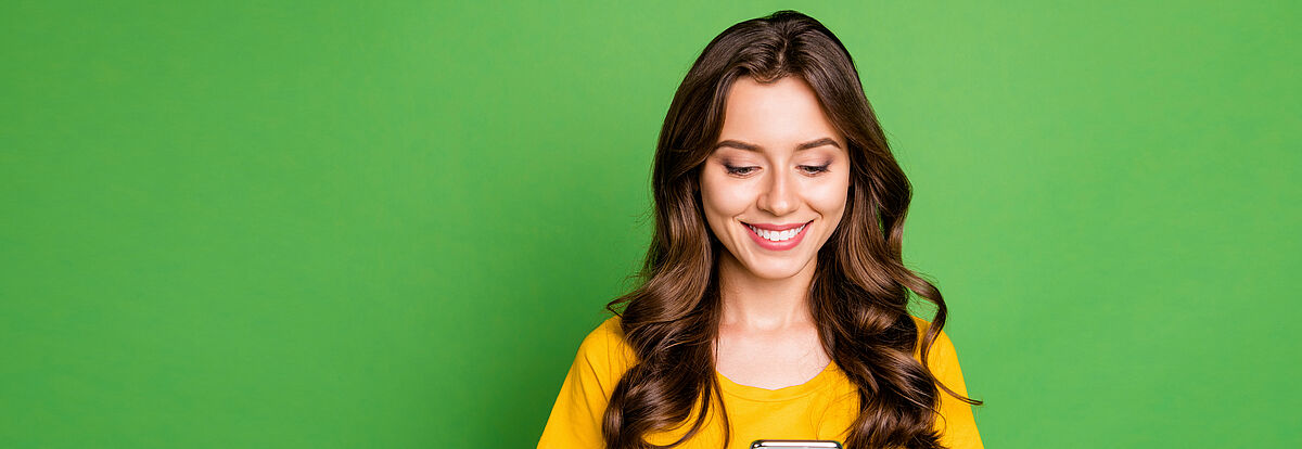 Portrait of her she nice attractive lovely pretty charming cute cheerful cheery wavy-haired girl writing sms message chatting online isolated on bright vivid shine vibrant green color background